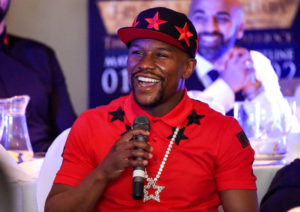 Floyd Mayweather Jr. is interviewed in front of fans at a small club in Cannock