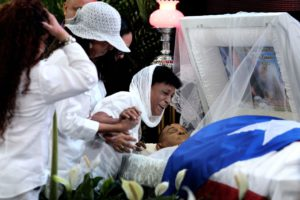 "Maria Matias cries over the body of her son, former Puerto Rican welterweight boxing champion Hector ""Macho"" Camacho, as he lies in state during his wake in San Juan"